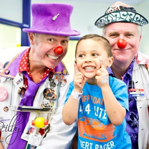 The Clown Doctors cheering up a pint sized patient