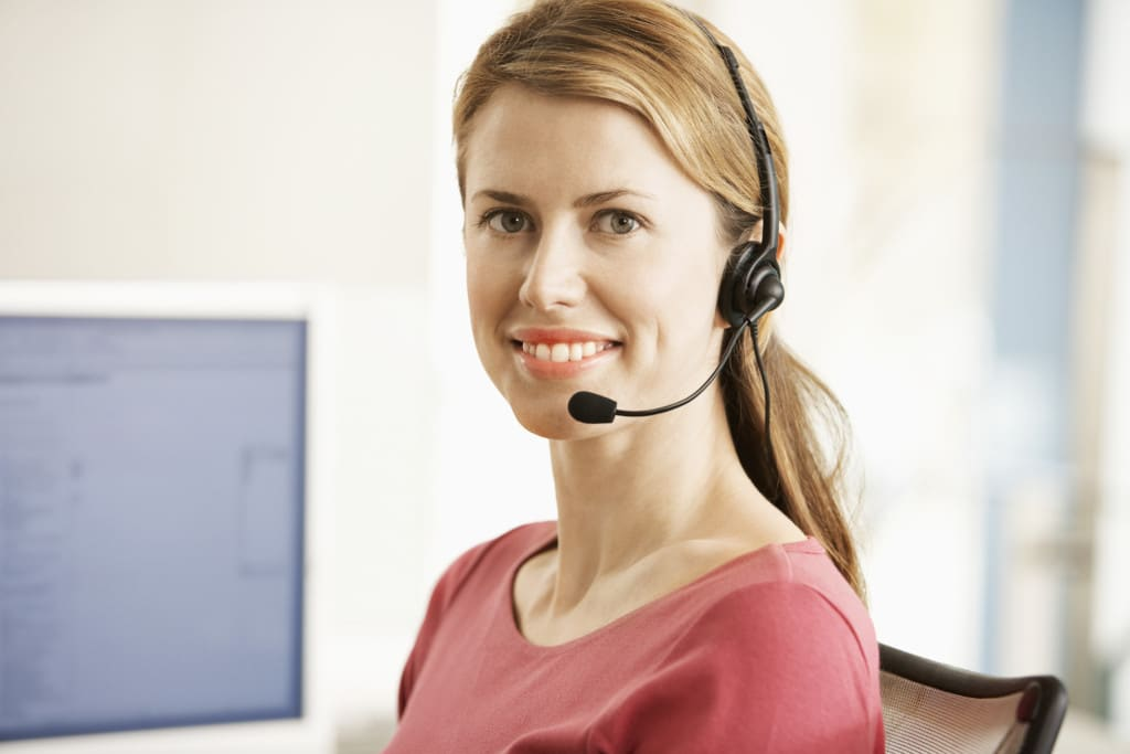 Office Worker Wearing a Telephone Headset